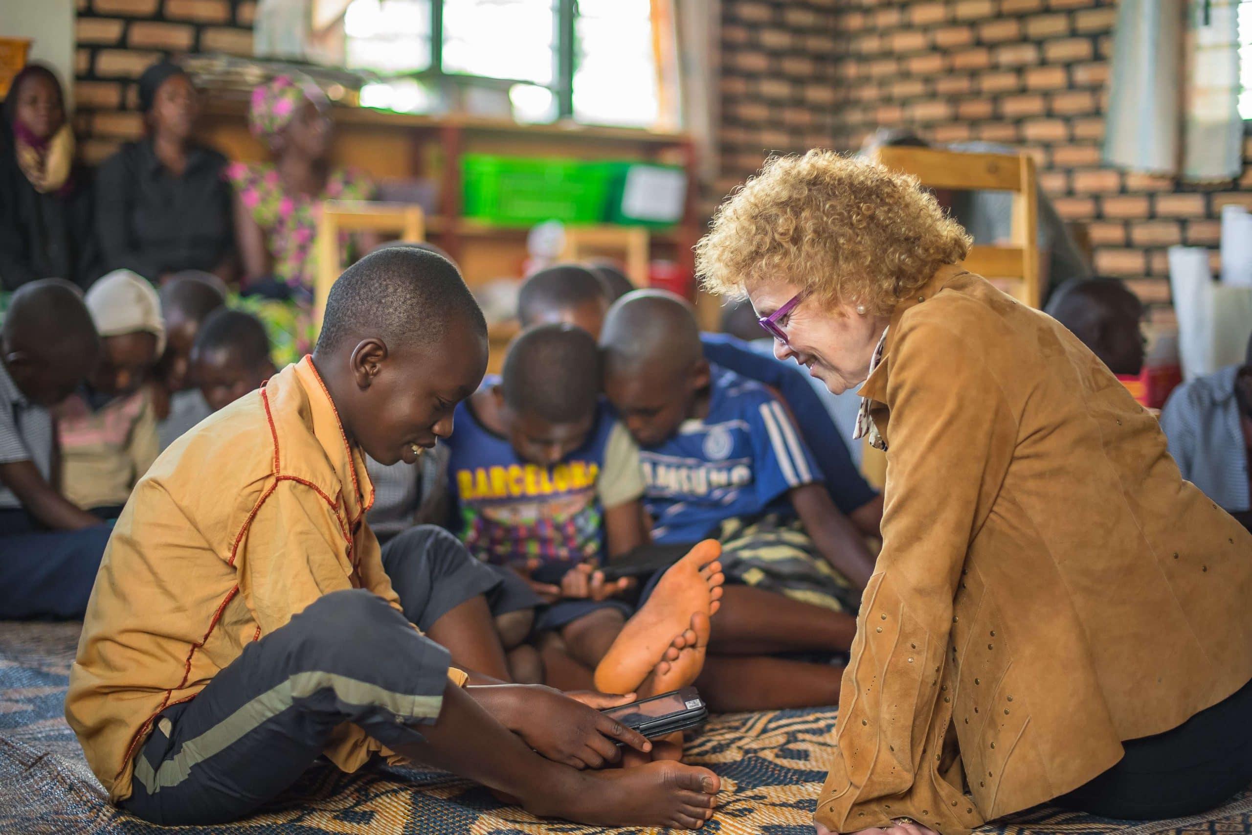 Dr Kathryn sitting down with children in Nabu